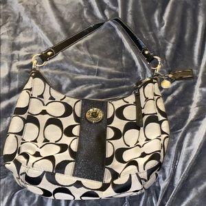 Black and grey fabric Coach shoulder bag.